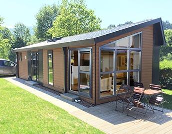 arcabo bereits seit 20 jahren europas gr ter spezialist im chaletbau. Black Bedroom Furniture Sets. Home Design Ideas